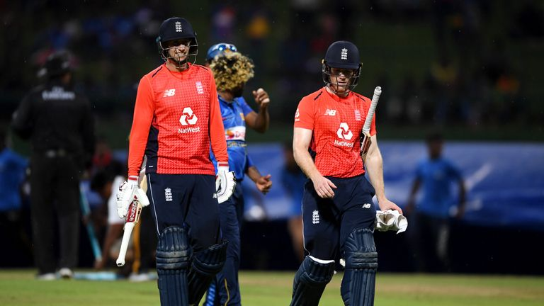 Joe Root and Eoin Morgan walk off in Kandy as the rain begins to fall