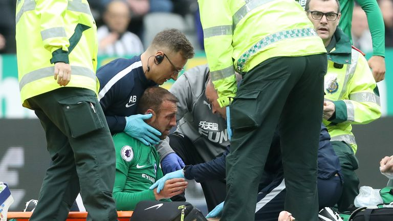Glenn Murray receives treatment at St James' Park on Saturday afternoon