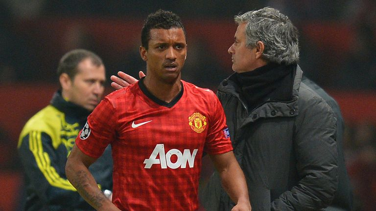 Real Madrid boss Jose Mourinho consoles a shocked Nani after his red card