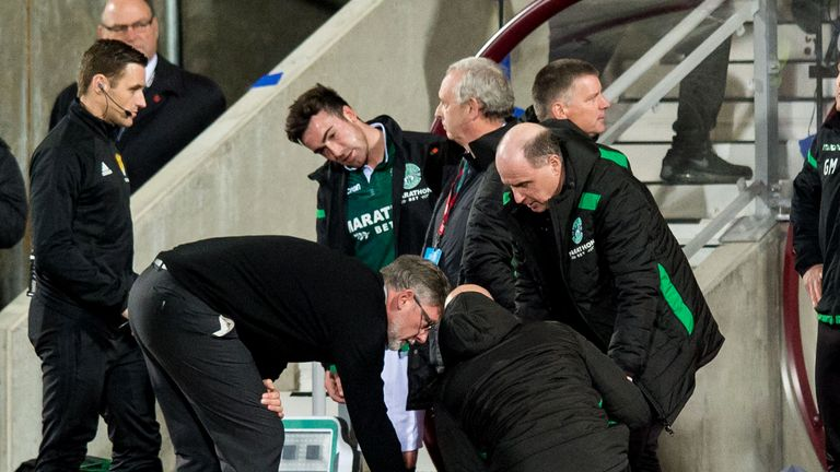 Hearts manager Craig Levein checks on Hibernian manager Neil Lennon after appearing to be struct by an object from the crowd