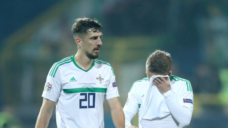 Northern Ireland's Craig Cathcart (left) and Steven Davis react to Bosnia taking the lead