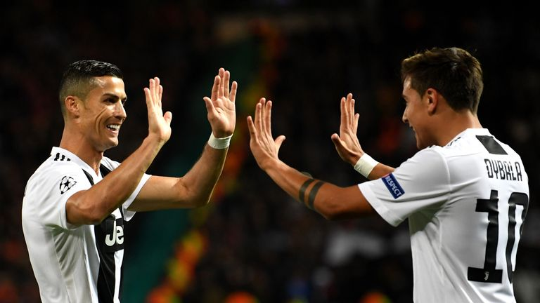Paulo Dybala celebrates scoring Juventus' first goal with team-mate Cristiano Ronaldo