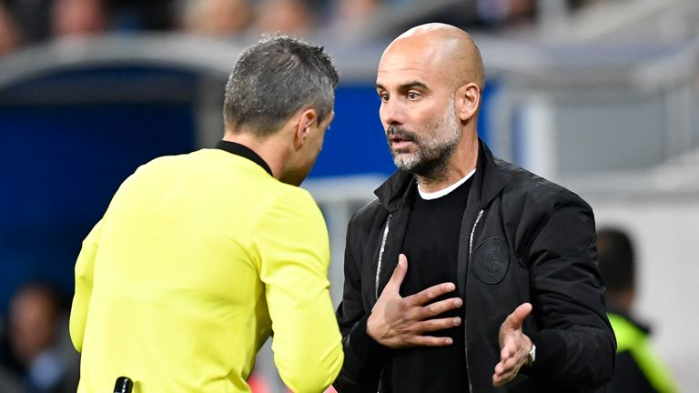 Pep Guardiola talks to the referee during Hoffenheim v Man City