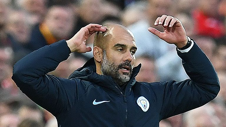 Pep Guardiola reacts during the Premier League match between Liverpool and Manchester City at Anfield