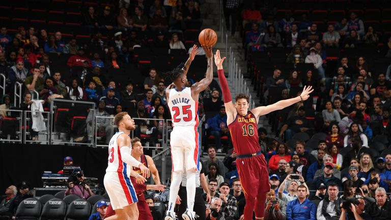 Reggie Bullock #25 of the Detroit Pistons shoots the ball against the Cleveland Cavaliers on October 25, 2018 at Little Caesars Arena in Detroit, Michigan.