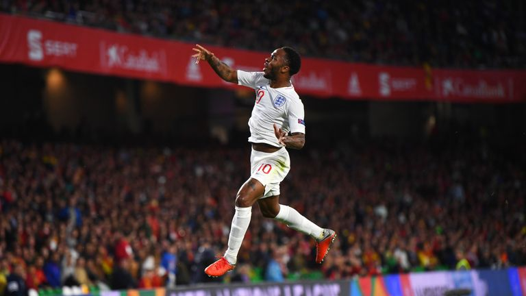 Raheem Sterling celebrates scoring his and England's first goal during the UEFA Nations League match against Spain in Seville