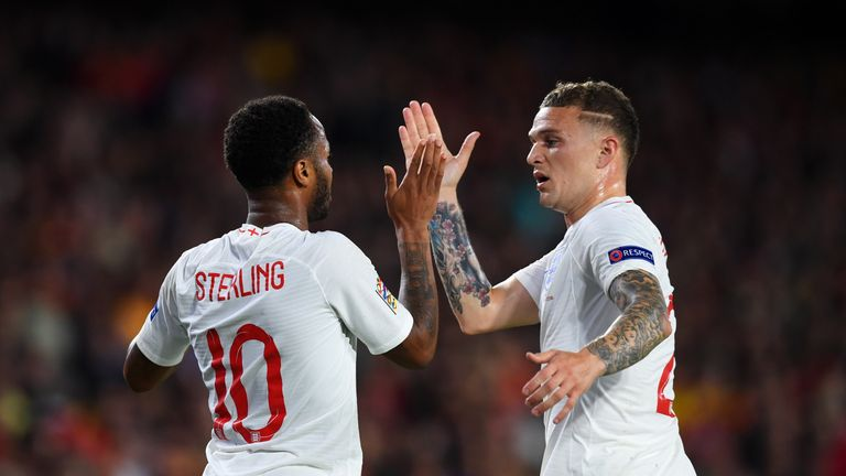 Raheem Sterling celebrates with Kieran Trippier