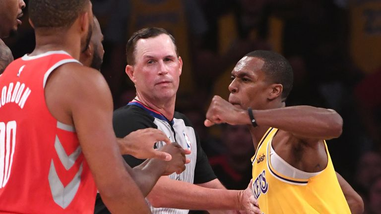 Los Angeles Lakers guard Rajon Rondo (9) throws a punch at Houston Rockets guard Chris Paul (3) as a fight broke out in the fourth quarter of the game