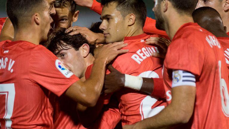 Real defender Alvaro Odriozola (third from the left) celebrates after scoring