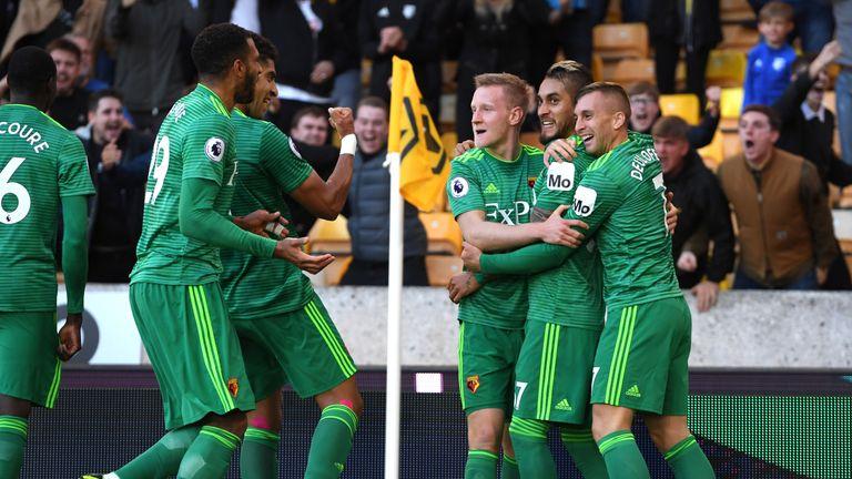 Roberto Pereyra celebrates with team-mates after scoring Watford's second goal