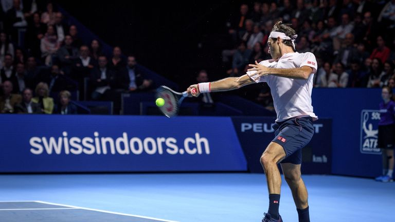 Federer powers on in Basel
