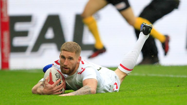 Sam Tomkins crosses for England's first try of the match