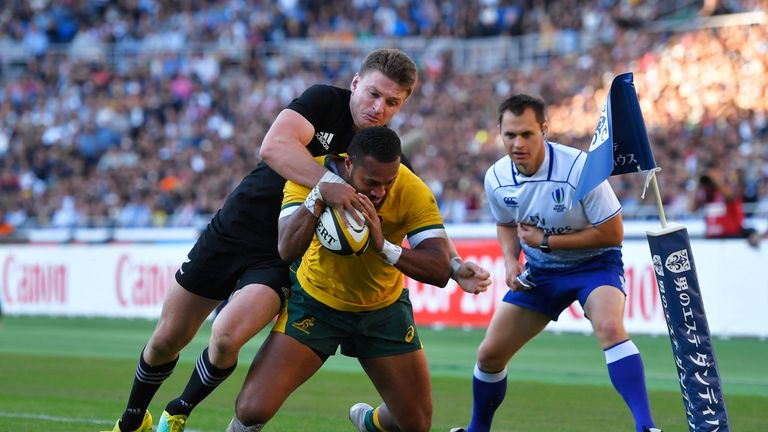 Sefa Naivalu on the way to scoring his try that put Australia firmly in the mix at half-time