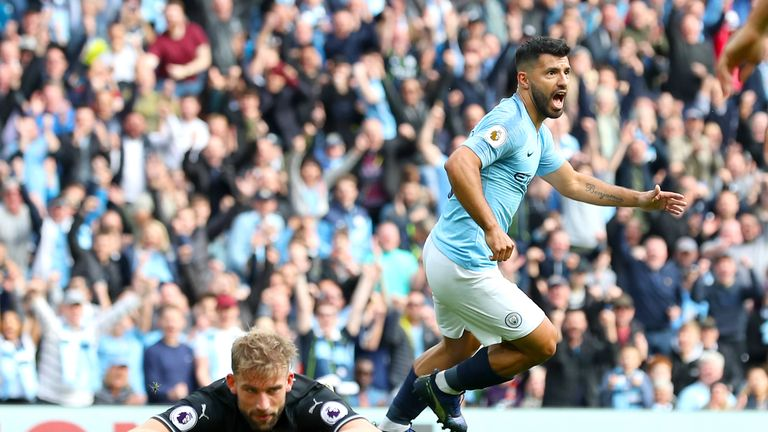 Sergio Aguero wheels away from goal after his opener