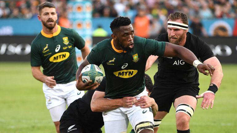Siya Kolisi of the Springboks tackled by Ryan Crotty
