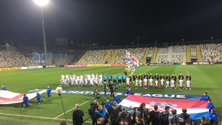The teams line up in Riejka - but the stands are empty