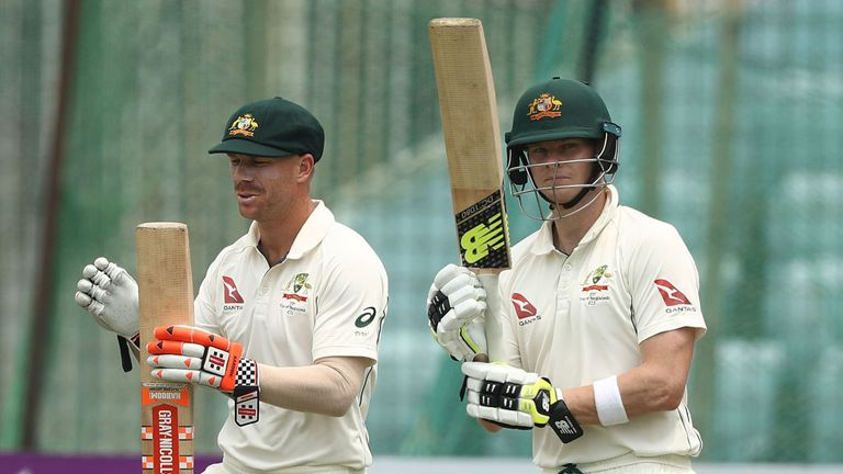 Warner (left) and Steve Smith head out to bat together for Australia