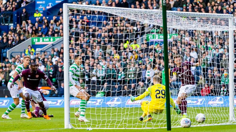 Hearts' Steven MacLean has the ball in the back of the net but the goal was disallowed