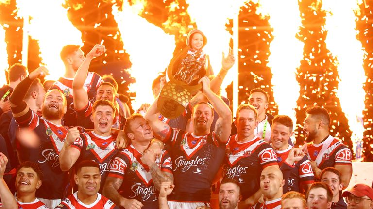 The Sydney Roosters celebrate with the tophy