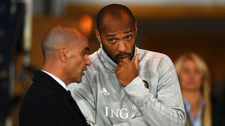 Martinez (left) says he hopes Henry gets a 'little bit of luck' in his new role