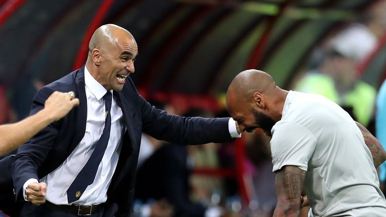 Roberto Martinez, Head coach of Belgium celebrates with Belgium assistant coach, Thierry Henry after their sides first goal during the 2018 FIFA World Cup Russia Quarter Final match between Brazil and Belgium at Kazan Arena on July 6, 2018 in Kazan, Russia.