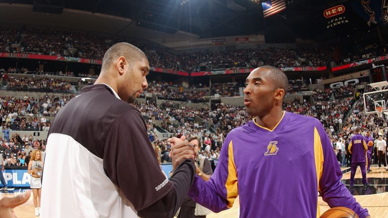 Kobe Bryant #8 of the Los Angeles Lakers greets Tim Duncan #21 of the San Antonio Spurs before Game five of the Western Conference Semifinals during the 2003 NBA Playoffs at SBC Center on May 13, 2003 in San Antonio, Texas. The Spurs won 96-94.