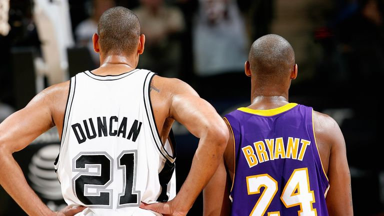 Tim Duncan #21 of the San Antonio Spurs and Kobe Bryant #24 of the Los Angeles Lakers stand together during the game on January 12, 2010 at the AT&T Center in San Antonio, Texas. The Spurs won 105-85