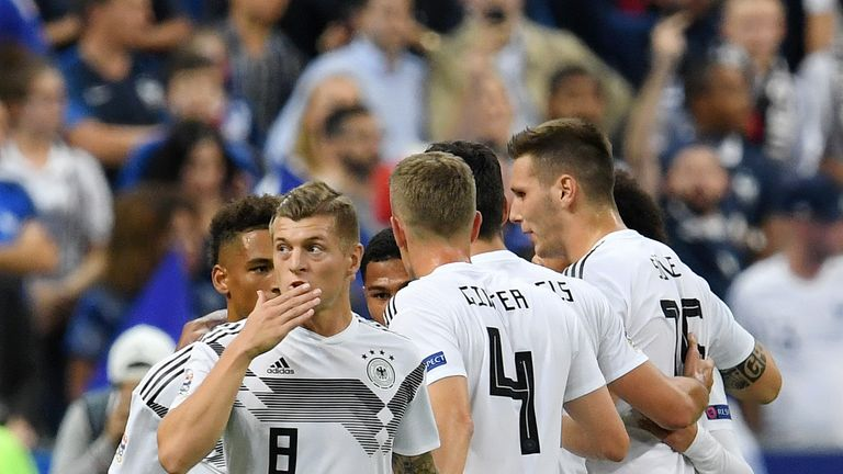 Toni Kroos celebrates putting Germany ahead from the penalty spot