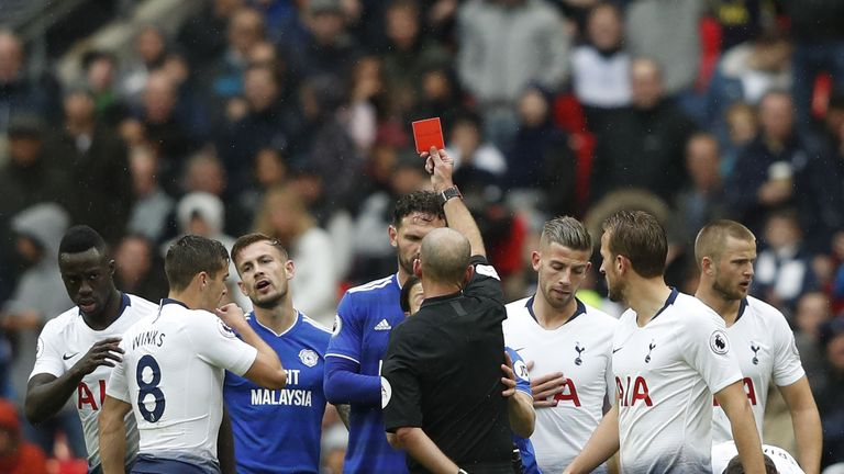 Mike Dean shows Ralls a straight red card for serious foul play
