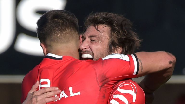 Toulouse's French full back Maxime Medard (R) celebrates with a teammate after scoring a try during the European Rugby Champions Cup rugby union match between Toulouse and Leinster at the Ernest Wallon stadium in Toulouse, southern France on October 21, 2018.