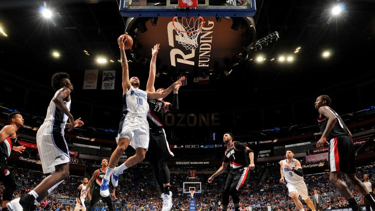 Evan Fournier #10 of the Orlando Magic goes to the basket against the Portland Trail Blazers on October 25, 2018 at Amway Center in Orlando, Florida