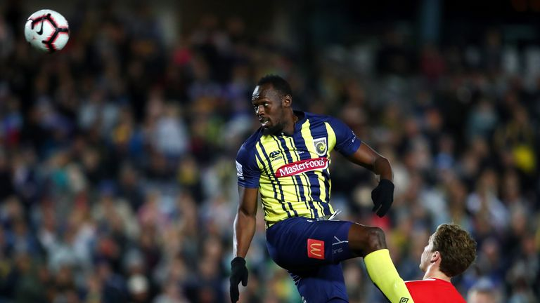 Usain Bolt competes for the ball during the pre-season match between the Central Coast Mariners and Central Coast Football