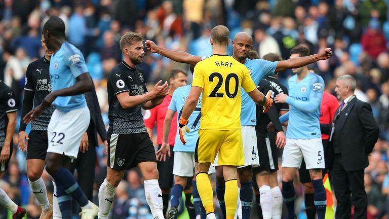 Vincent Kompany and Joe Hart embrace after Man City's 5-0 win over Burnley