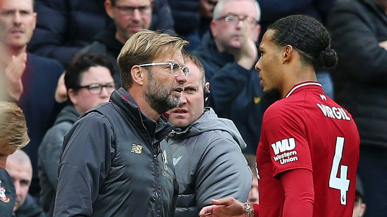 Virgil van Dijk of Liverpool is greeted by Jurgen Klopp, Manager of Liverpool as Virgil van Dijk is substituted off during the Premier League match between Liverpool FC and Southampton FC at Anfield on September 22, 2018 in Liverpool, United Kingdom