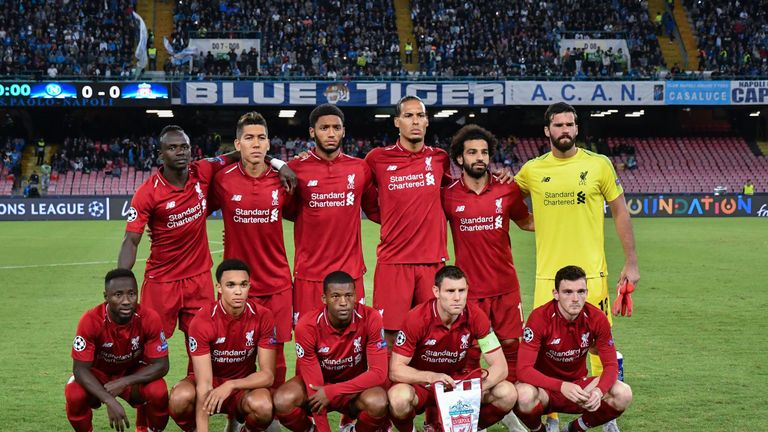 Virgil van Dijk and Mohamed Salah line up prior to Liverpool's UEFA Champions League group match against Napoli
