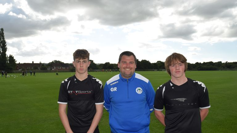 Gregor Rioch with young Wigan players Jensen Weir and Joe Gelhardt [Credit: Simon Whitehead, Wigan Athletic]