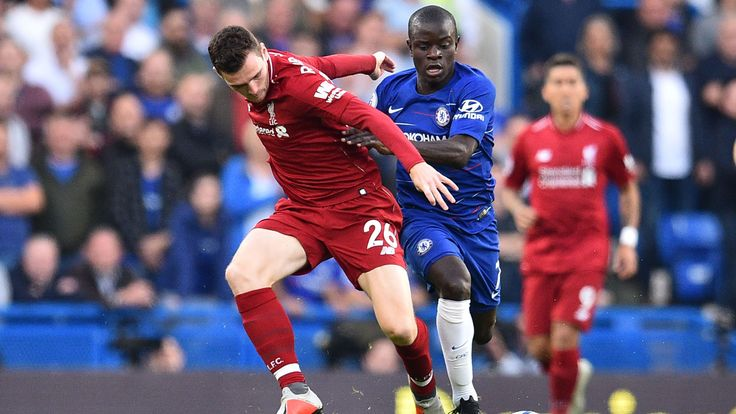 Liverpool's Andrew Robertson and Chelsea's N'Golo Kante vie for the ball