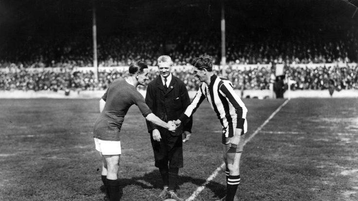 31st August 1919: The captains of Woolwich Arsenal and Newcastle United shake hands before the start of the opening match of the season.