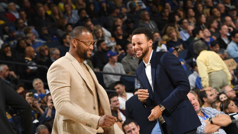 Stephen Curry, on the sidelines with DeMarcus Cousins, has been a big miss for the Warriors