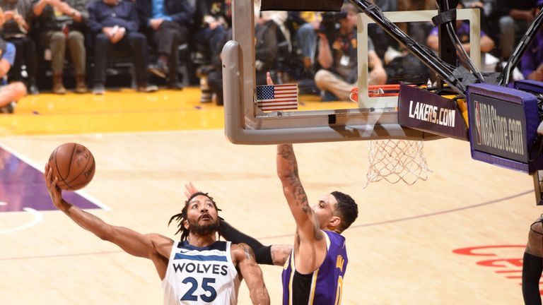 Derrick Rose lifts a scoop shot beyond the reach of Kyle Kuzma