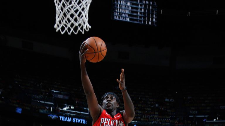 Jrue Holiday scores with a lay-up against Washington