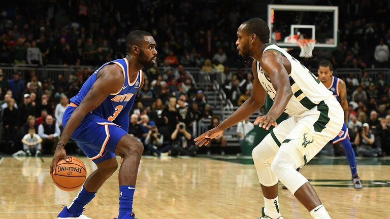 Khris Middleton defends the three-point line against the New York Knicks