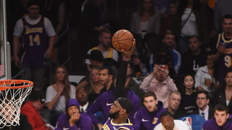 LeBron James dunks on the Minnesota Timberwolves