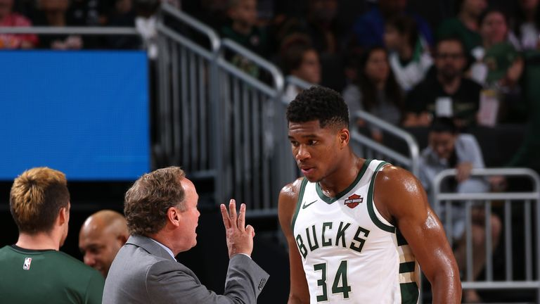 Coach Mike Budenholzer explains his tactics to his star player Giannis Antetokounmpo