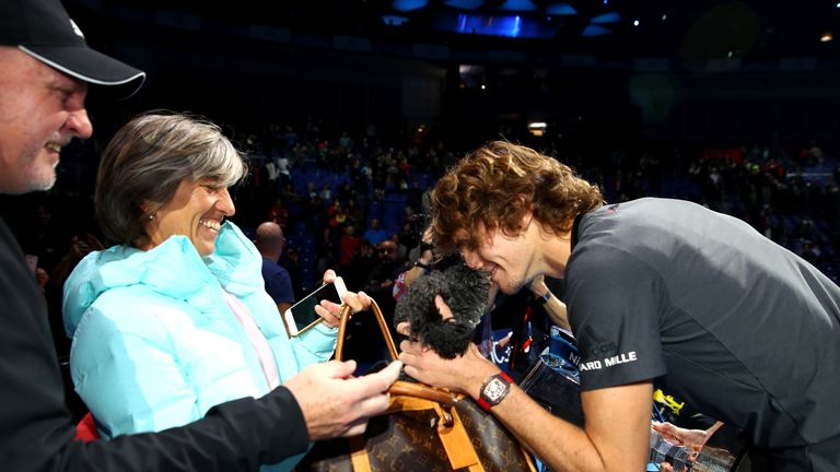 Zverev celebrates with his mum, Irina Zvereva, and the adorable family dog, Lovik