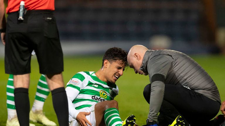 Daniel Arzani receives treatment during Celtic's 5-0 win over Dundee