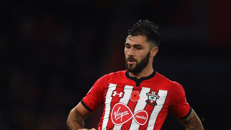 Charlie Austin will be suspended for Southampton's FA Cup replay