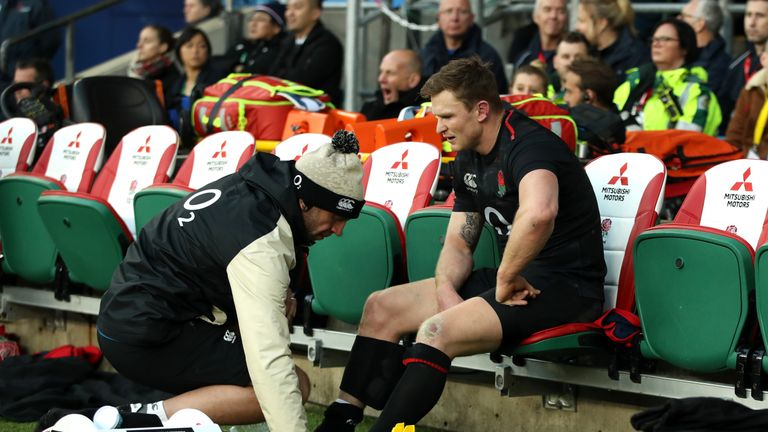 Chris Ashton receives treatment during the Quilter International match between England and Japan at Twickenham