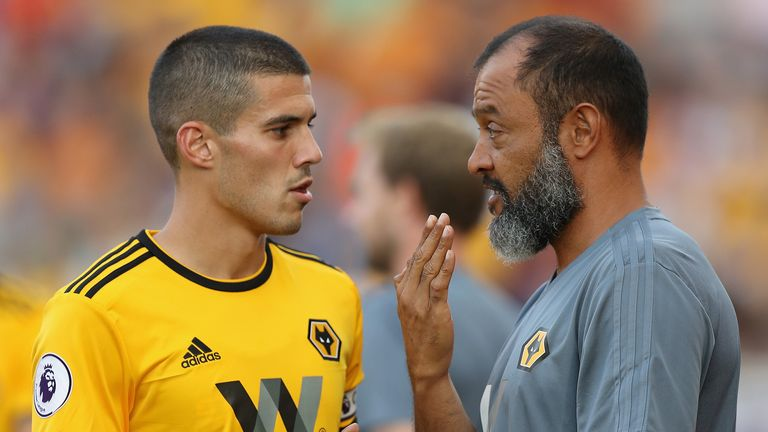 Nuno Espirito Santo, (R) the Wolverhampton Wanderers manager talks to his captain Conor Coady during the pre-season friendly match between Stoke City and Wolverhampton Wanderers at the Bet365 Stadium on July 25, 2018 in Stoke on Trent, England.