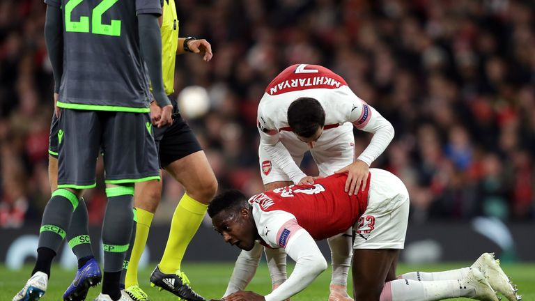 Henrikh Mkhitaryan stands over Danny Welbeck after he was injured against Sporting Lisbon